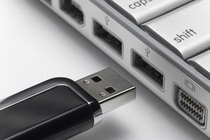 Flash Drive being put in computer usb port