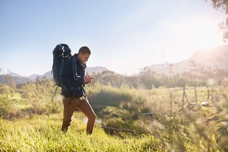Man walking in country with GPS