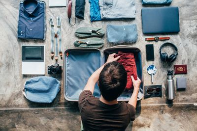 Man packing bag for trip