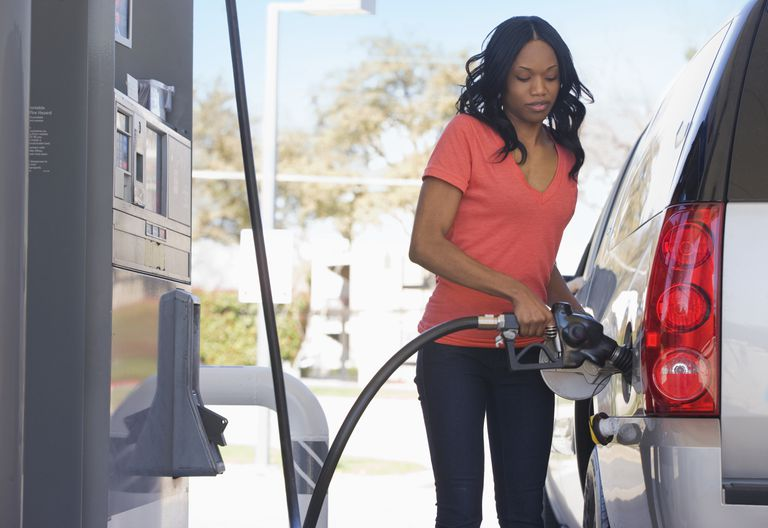 Woman filling gas tank