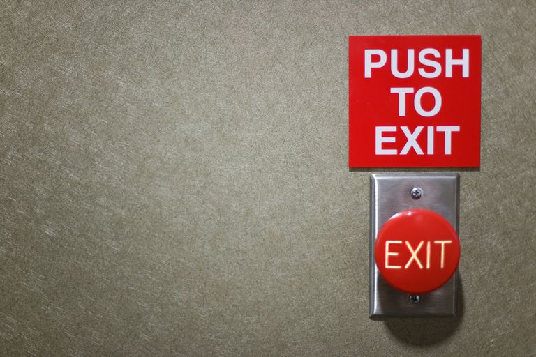 Photo of a 'PUSH TO EXIT' sign and button