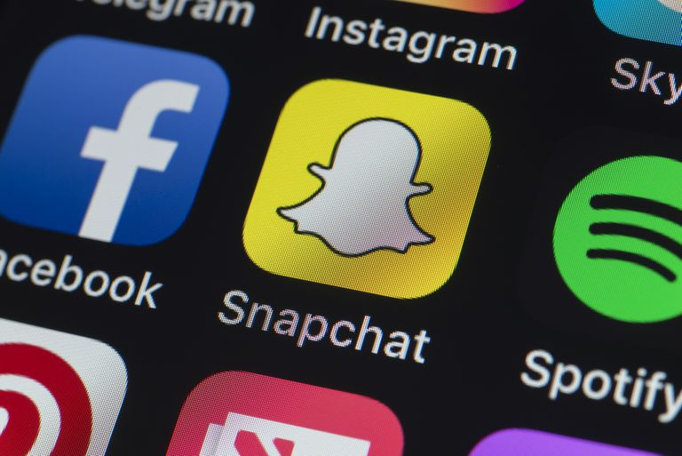 An image of the Snapchat app icon on a mobile device.