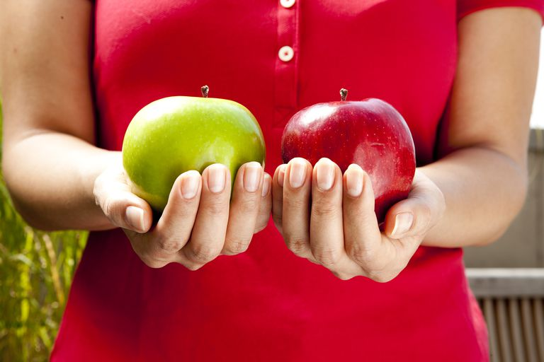 Woman holds two apples