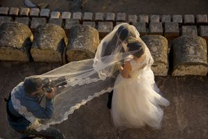 Photographer shoots a couple during their wedding