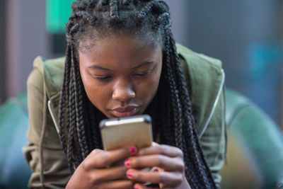 A woman looking at her smartphone intently