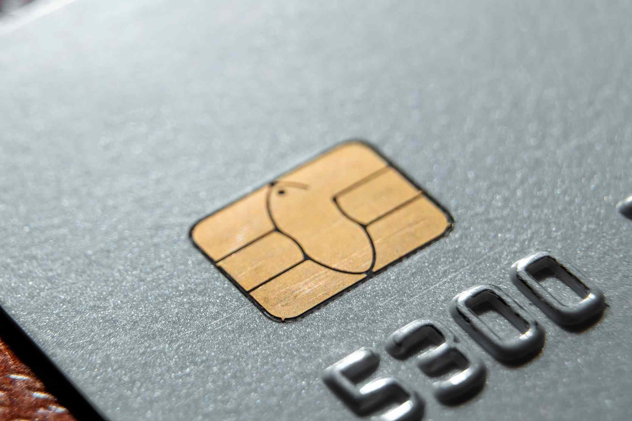 Micro credit card chip close-up, soft focus