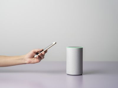 A home owner tries to fix an Alexa multi-room speaker with a phone.