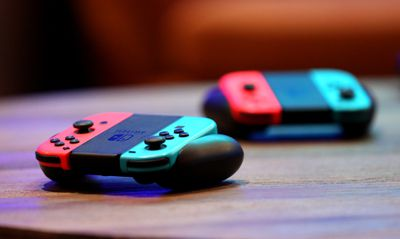 Two Nintendo Switch controllers on a wooden table