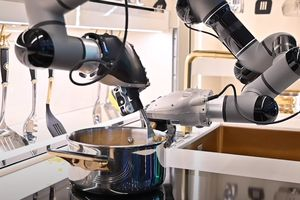 Robotic arms cooking a meal on a kitchen stove without human assistance