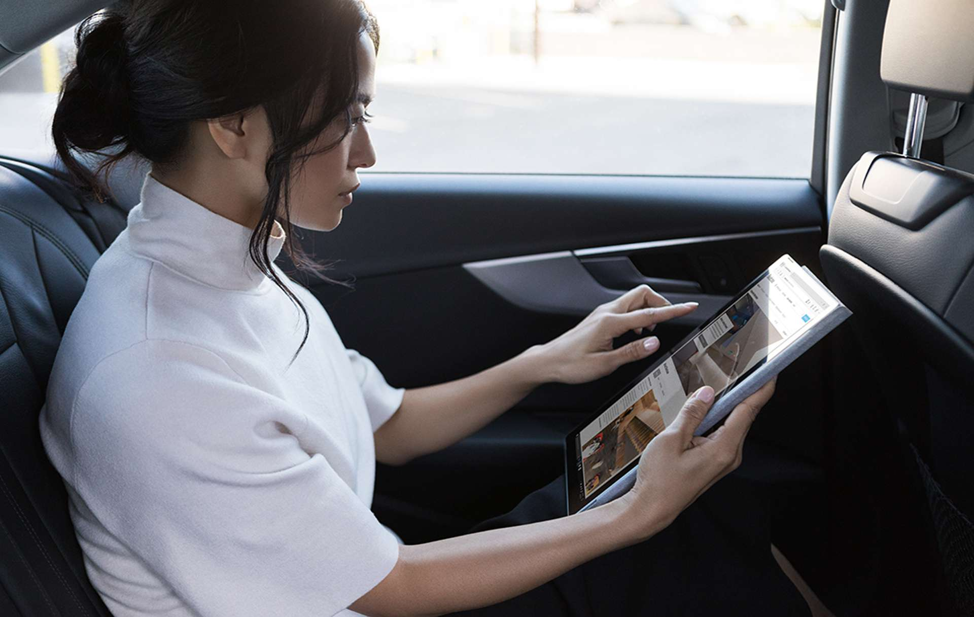 A woman taking a screenshot on a Surface Pro.