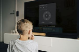 A boy waits as his parent uses Firestick parental controls to activate FreeTime.