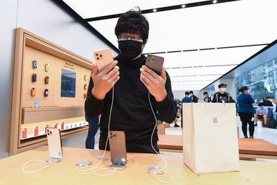 A customer at the Apple Store on George Street on November 13, 2020 in Sydney, Australia