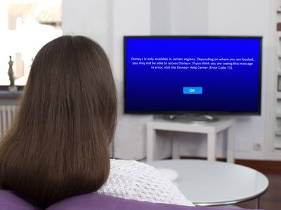 A woman sees Disney Plus error code 73 on her TV.