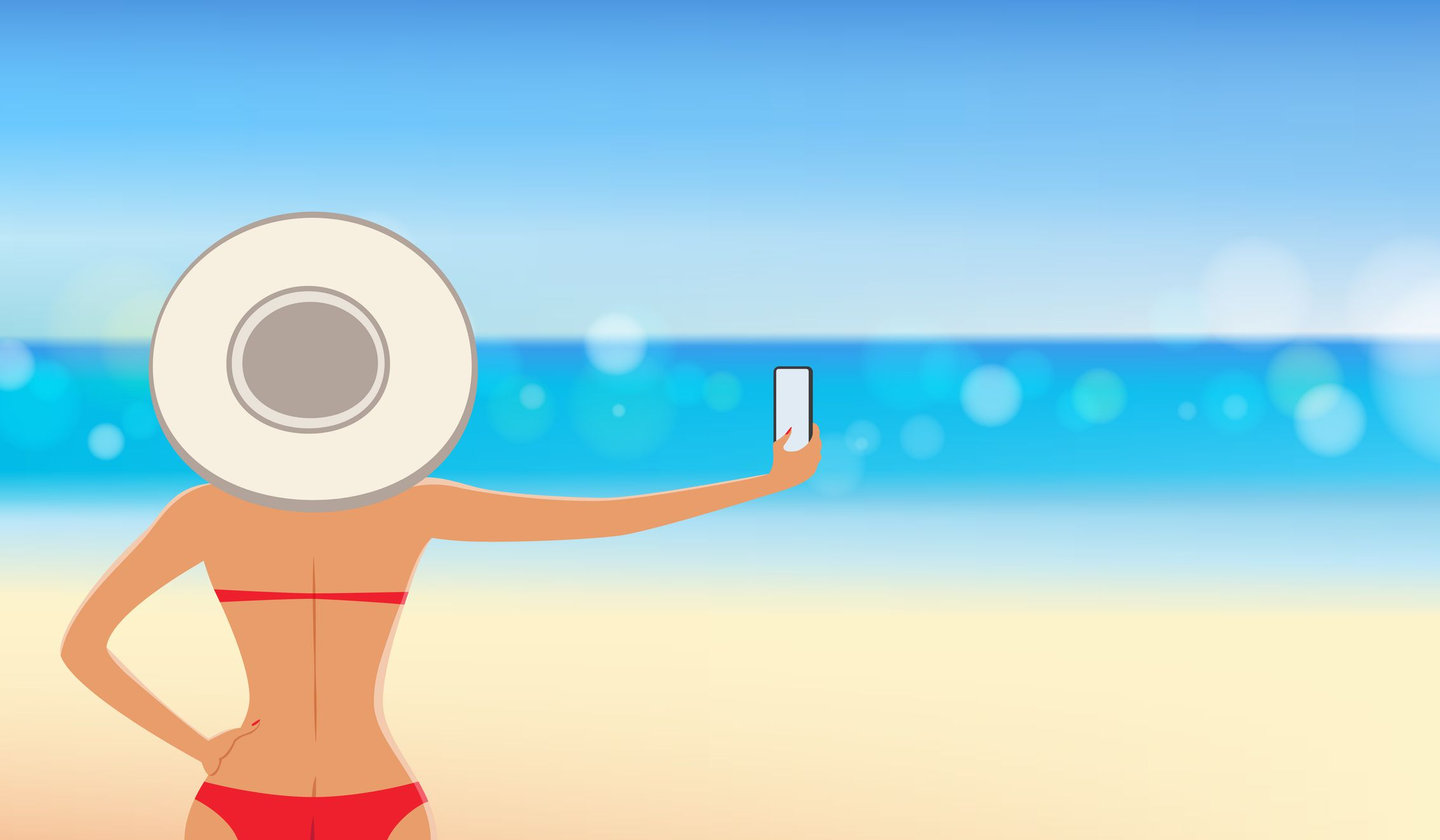 A woman taking a selfie on the beach.