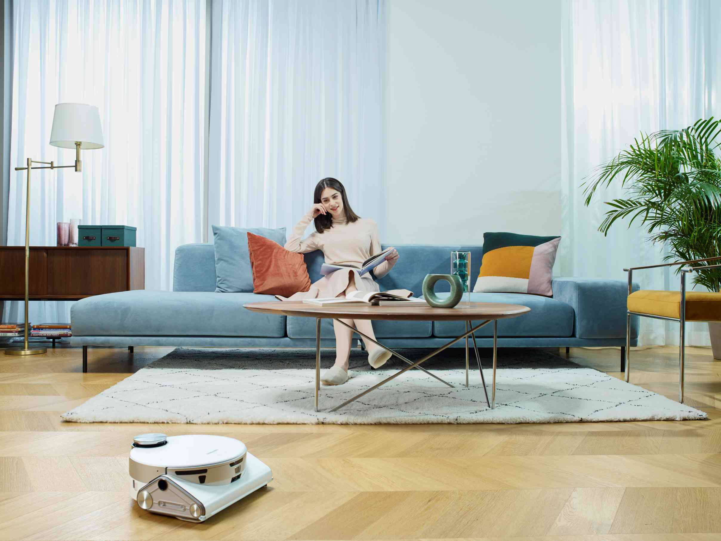 A Samsung Jetbot AI+ vacuuming a home.