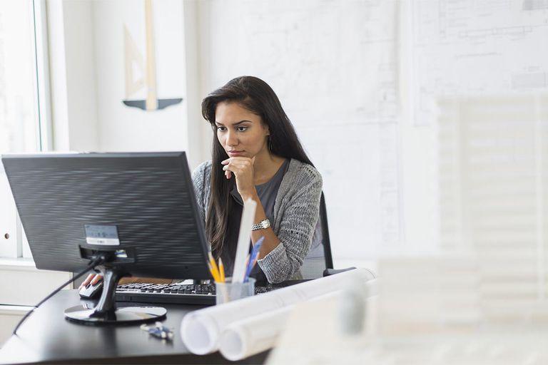 Hispanic businesswoman working in office