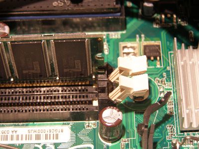 Picture of empty memory modules on a motherboard
