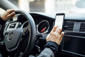 Image of a woman using navigation on her phone