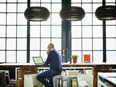 Businessman working on spreadsheet