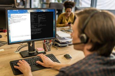 A person creates a batch file on a Windows 10 computer.