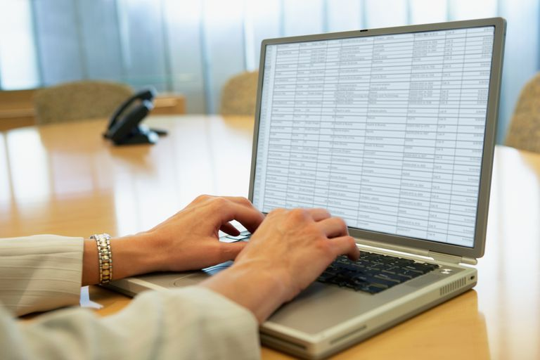 Saving an Excel spreadsheet as a template, as depicted by woman's hands at laptop with spreadsheet on the screen
