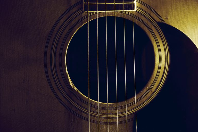 Close up of guitar hold and guitar strings