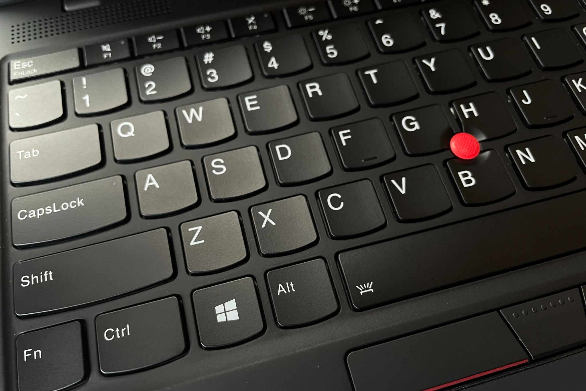 A photo of a Lenovo laptop keyboard with the Function and Spacebar keys shown