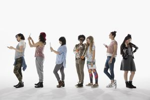 Cool young women using cell phones