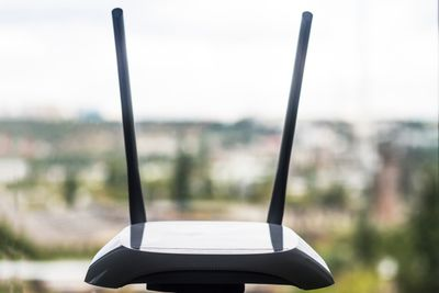 Wireless router in front of a window
