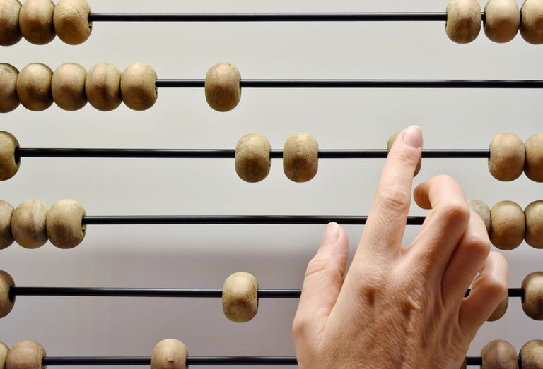 Hand moving beads on abacus