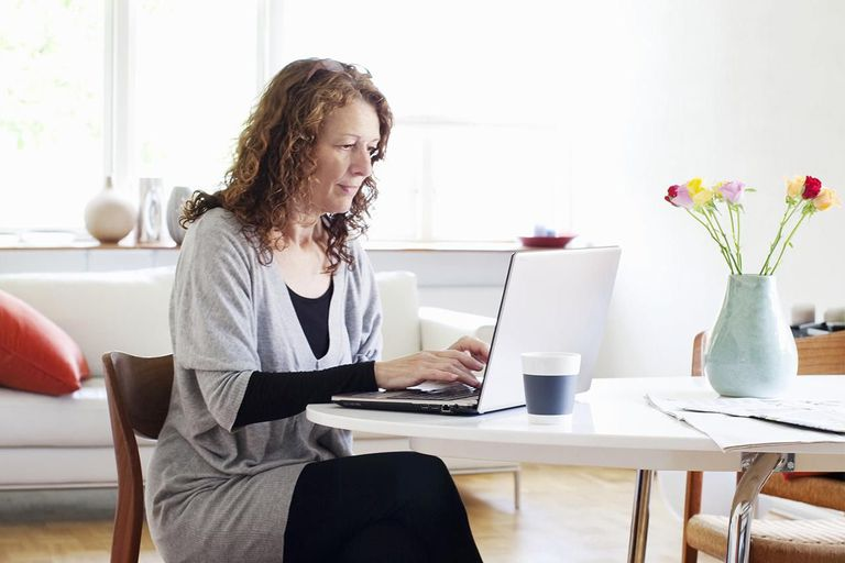 Woman working on computer at home.