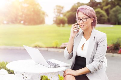 Sales rep talking on phone outdoors