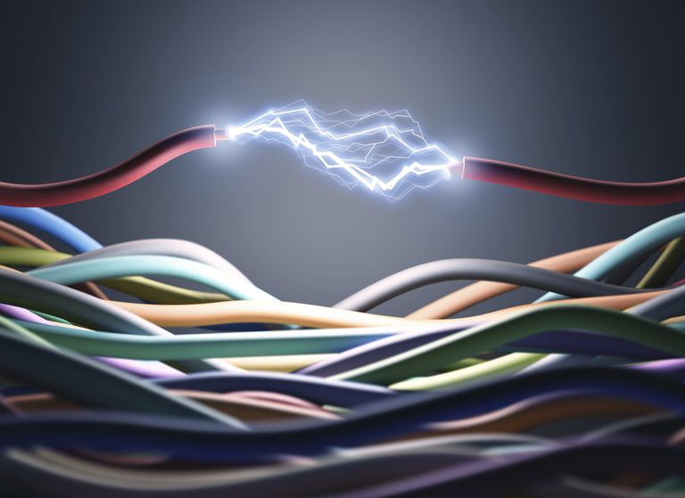 Many different colored wires to a power connection with a red wire cut with an electrical current