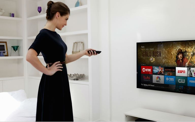 A woman checking the apps on her Fire Stick.