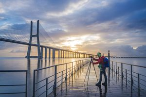 Photographer Taking A Creative Shot Of Bridge