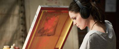 A woman wearing Bose headphones