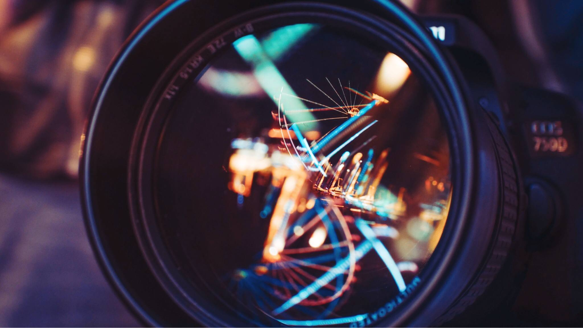 Reflections on a camera lens attached to a Canon DSLR