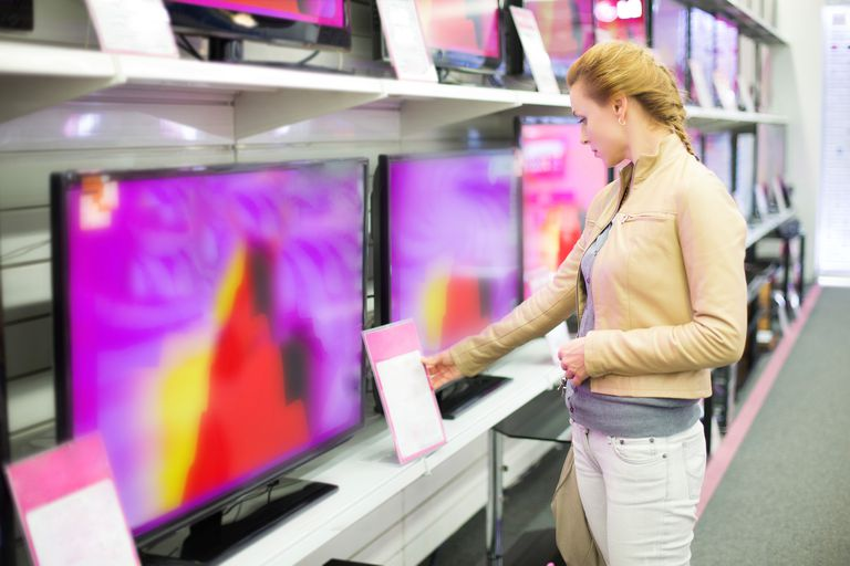 Woman shopping for smart TVs