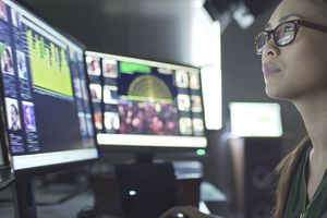 Data analyst looking at computer screens with information on them