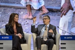 Melinda and Bill Gates attend a session at the Congress Center during the World Economic Forum
