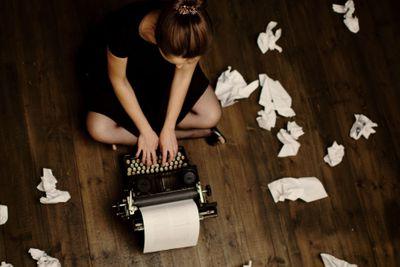 Writer working on typewriter on the floor