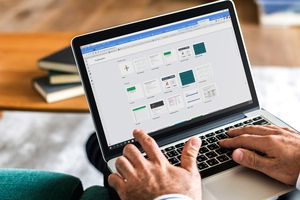 A man using Google Sheets on a MacBook Pro.