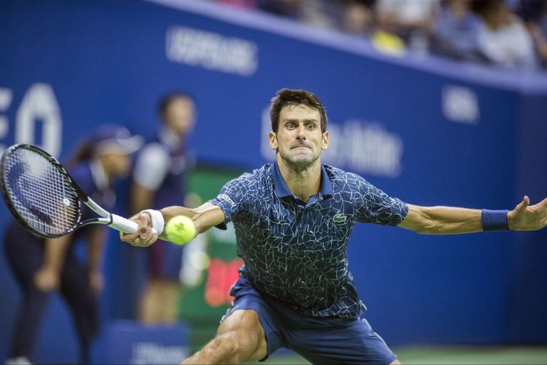 Novak Djokovic battles his way to victory at the US Open Tennis Championship.