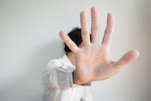 A man blocking his face