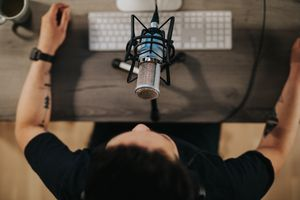 High angel view of a podcaster behind microphone