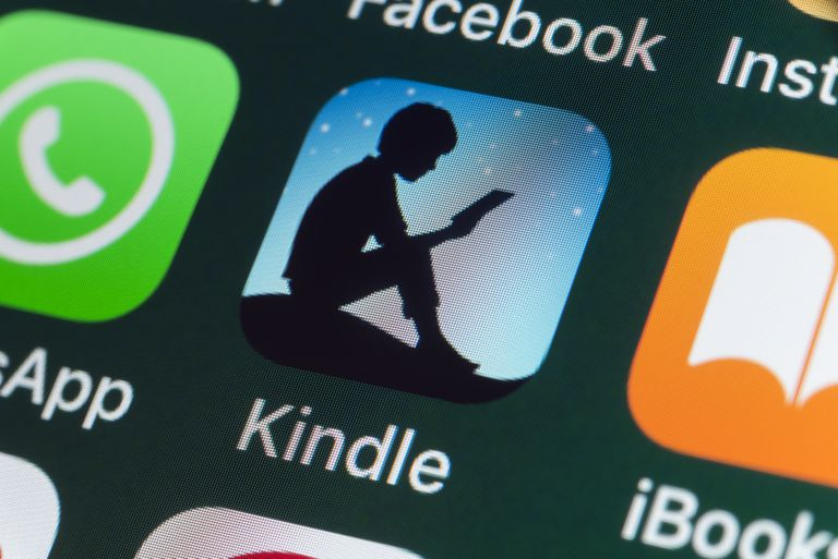 An image of the Kindle app icon on a smartphone screen.