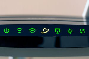 Green and yellow LED lights on a modem router hybrid device.