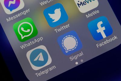 In this photo illustration, the logos of social media applications Messenger, WhatsApp, Twitter, MeWe, Telegram, Signal and Facebook are displayed on the screen of an iPhone.
