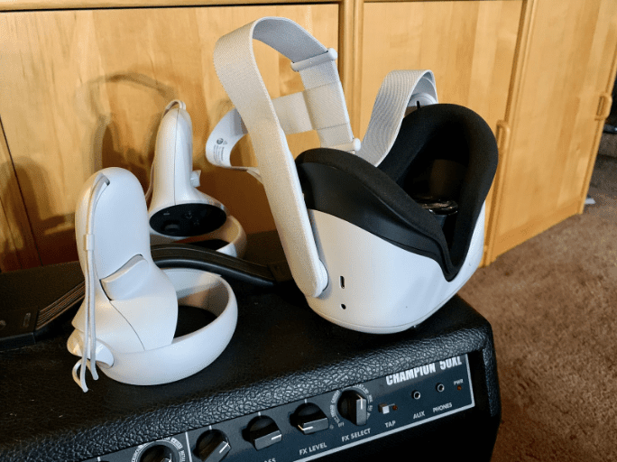 Oculus Quest 2 and wireless touch controllers resting on an amp