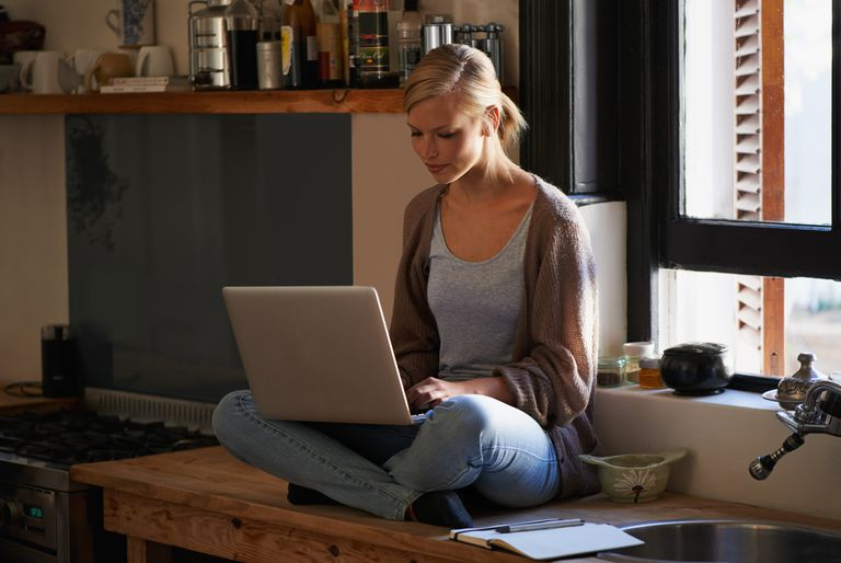 Woman blogging on counter